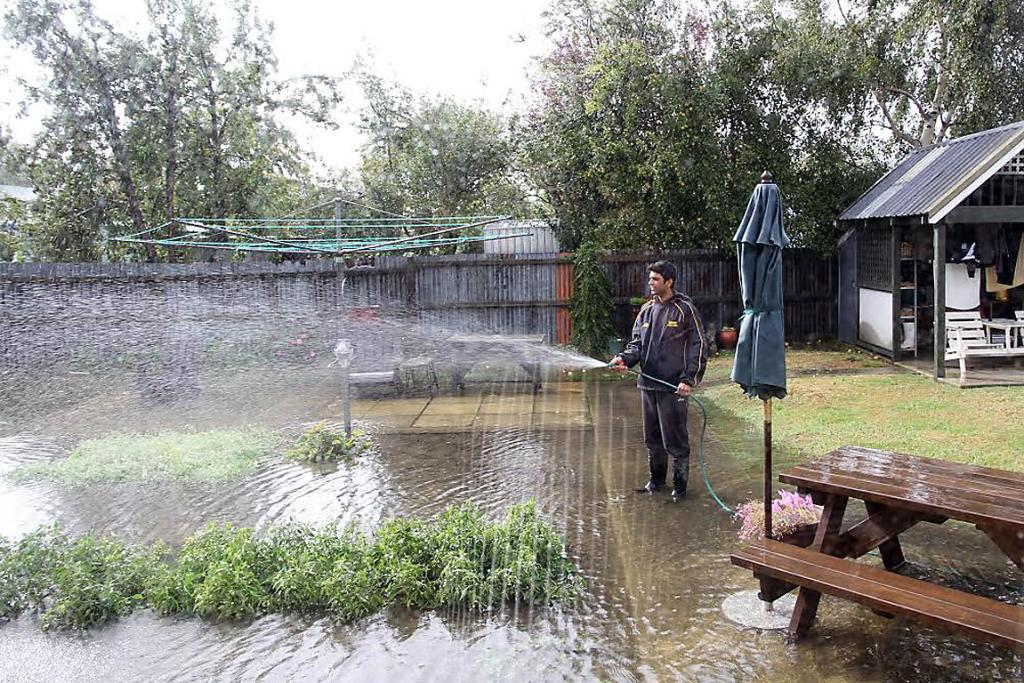 "NO SPRINKLERS NEEDED: ""Sorry Christchurch, I over-watered the garden,"" wrote Rajeev Bhana when he sent in this snap of a flooded garden."
