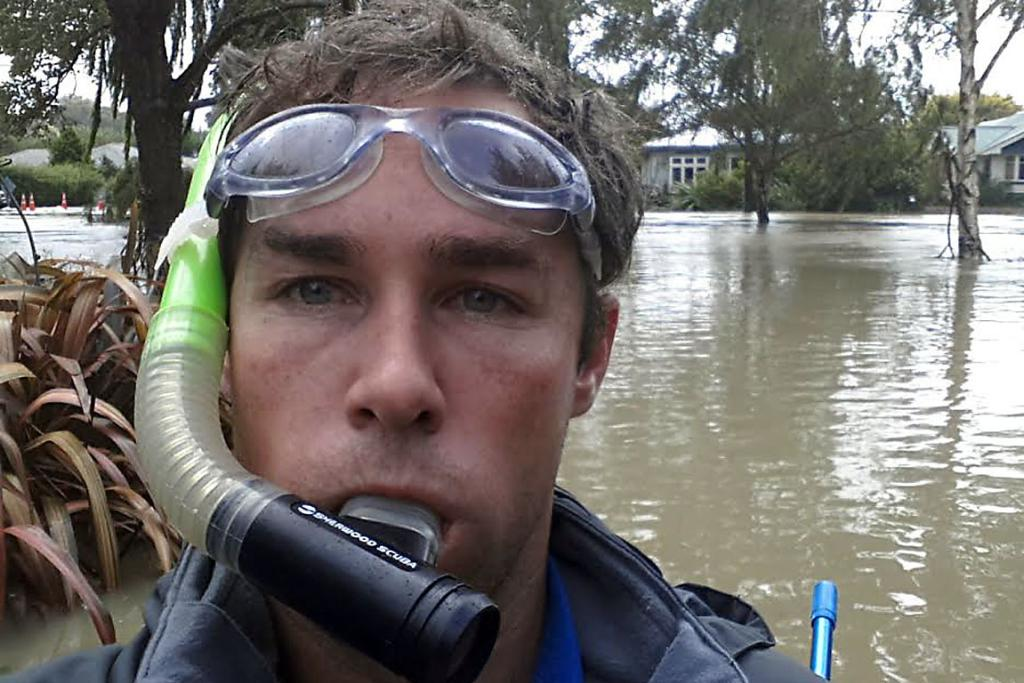 SCUBA SEASON: Josh Smith needs diving equipment to locate the road in Riverlaw Tce, St Martins.