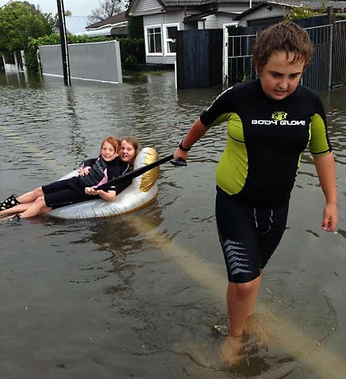 BROTHERLY LOVE: Mario Williams of Matlock St, Woolston, takes his sisters Mia and Natalia for a ride down the road during a break in the storm.