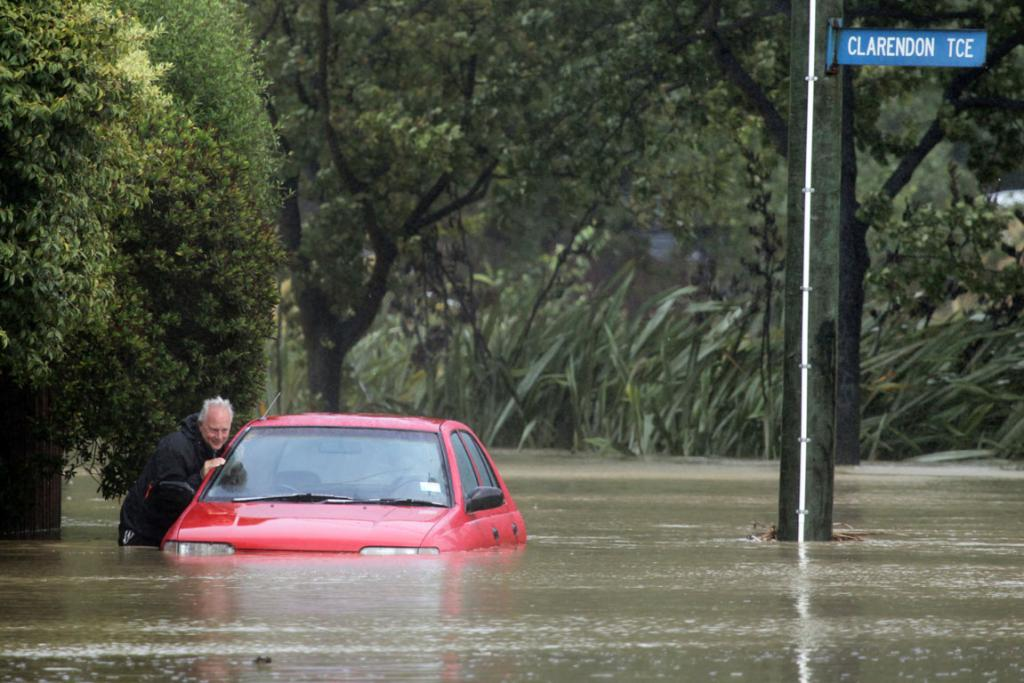 Glen Fife tend to his sunken car just off Clarendon Terrace in Woolston.