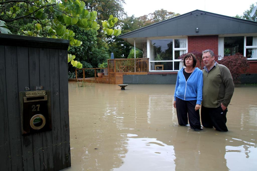 Flood walkabout in Christchurch including North Beach, Avonside and Opawa/Woolston. Aynsley Terrace residents Pip Oliver, left, and partner Tak Tothill.