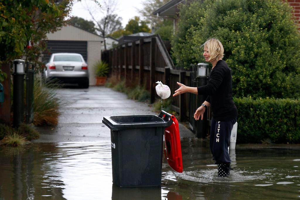 NEWPORT ST: Sarah Roberston tosses away her son's dirty nappies, found floating down the street.