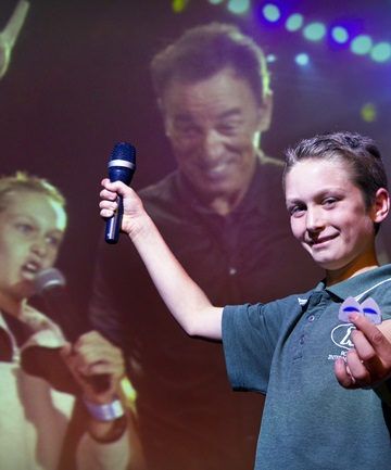 STILL IN SHOCK: Jacob Neave, 12, with the guitar picks that The Boss gave him.