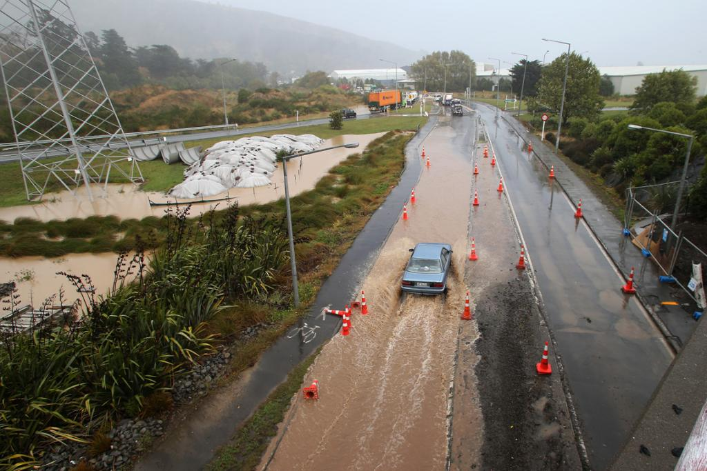 MAKING WAVES: Sodden ground and flooded roads made for treacherous driving conditions on Tunnel Road in Heathcote.