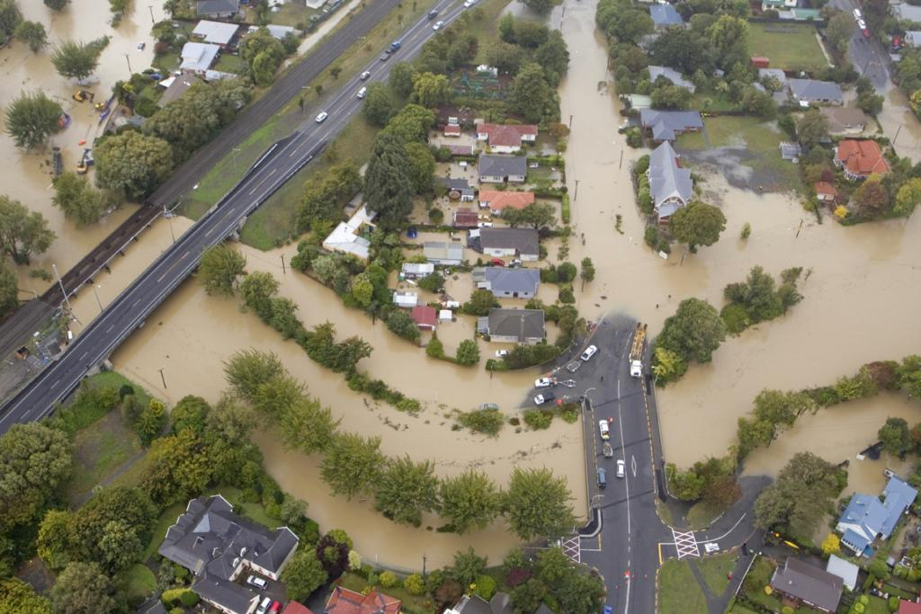 FLOODED STREETS: An aerial photograph of the Heathcote River flooding Opawa. The Brougham Street bridge can be seen to the left, with Opawa Road running down the middle. Clarendon Tce and Aynsley Tce, which run along the river, are both submerged.