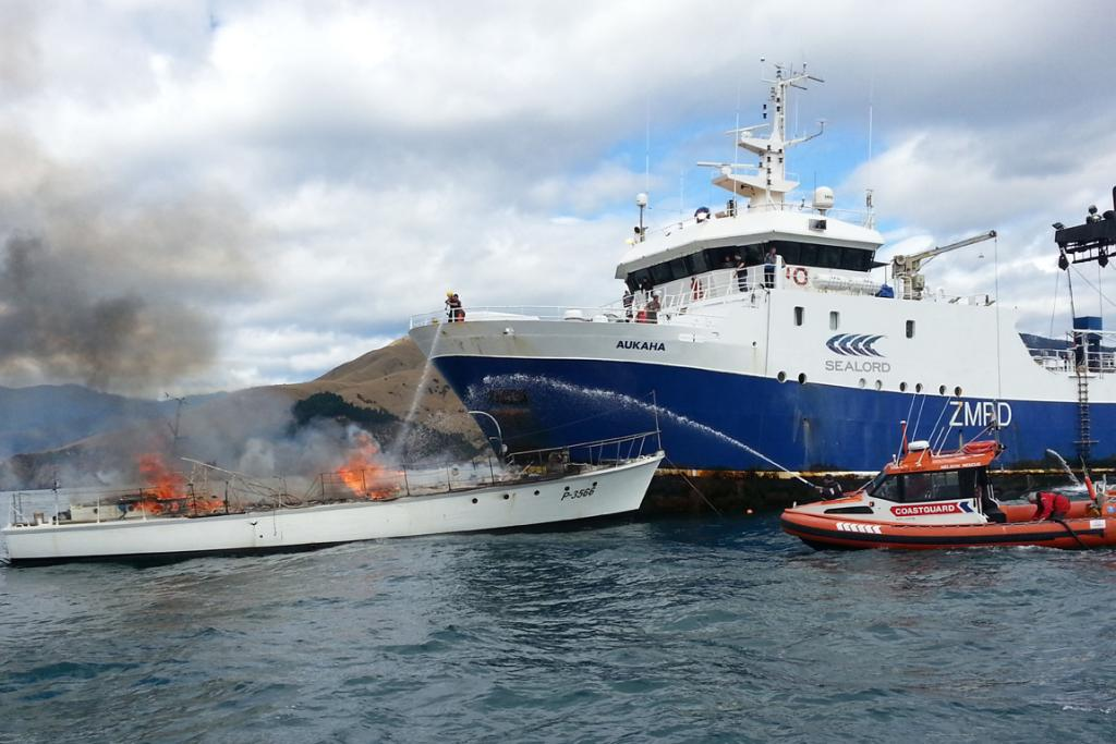 HELP ARRIVES: The Sealord trawler Aukaha and the Nelson Coastguard boat fight the fire.