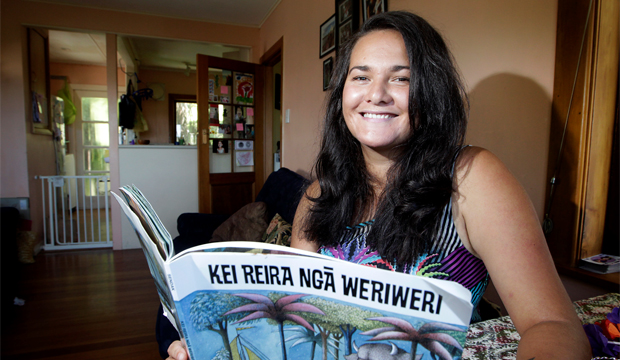 TINO PAI TALE: Te Kaureremoa Taumata with a Maori-translated copy of the children's classic Where the Wild Things Are, which she is using to give tips on storytelling in her Writers Week talk.