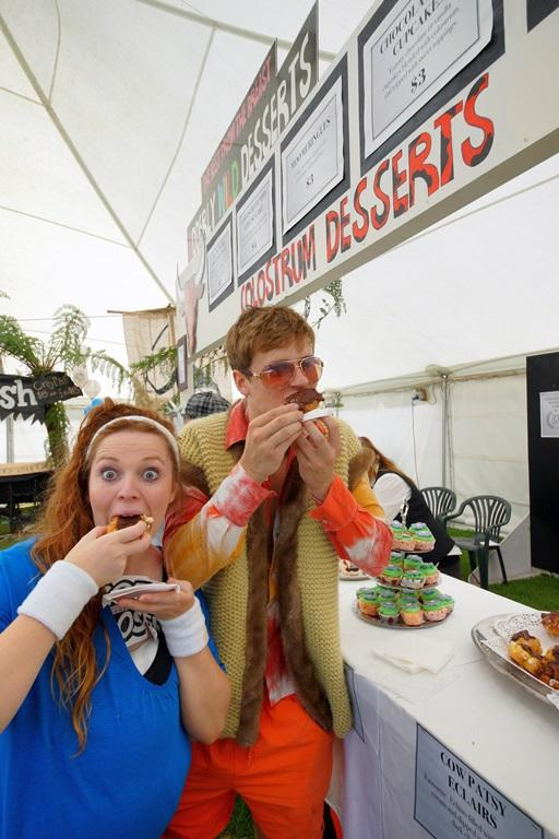 Canterbury University students Hayley Turner, 20, and Peter Whyte, 20, try out the delicious treats at the Udderly Wild Desserts stall.