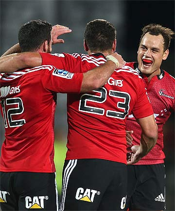 AT LAST: Crusaders players celebrate victory over Stormers in Christchurch.