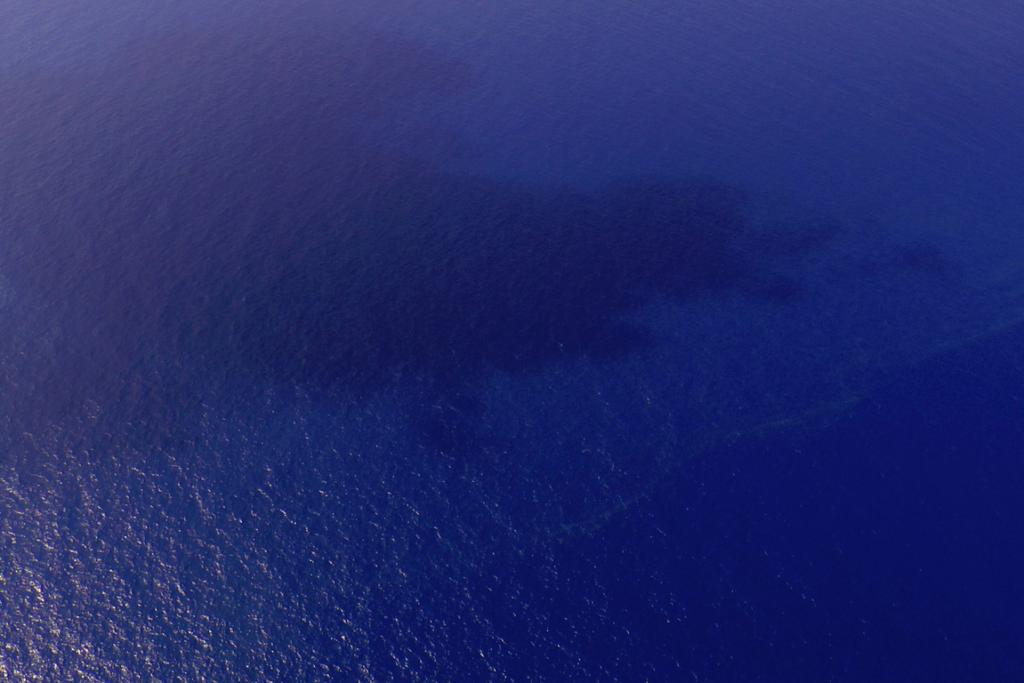 A view of oil slicks (pale line near the bottom right) spotted in an area of the South China Sea about 100 nautical miles (185 km) from Tok Bali Beach in Malaysia's Kelantan state.