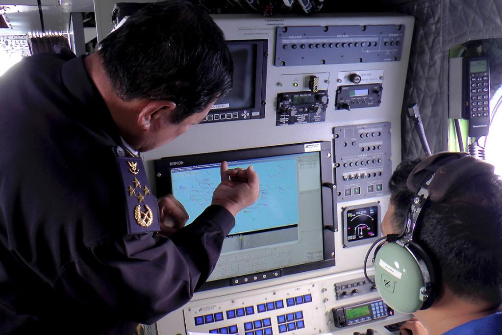 Admiral Datuk Mohd Amdan Kurish, Director General of the Malaysian Maritime Enforcement Agency, looks at a radar screen while searching for a missing Malaysia Airlines plane in the South China Sea.