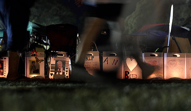 MEMORIES STRONG: Saturday evening's candles in paper bags serve as a memorial to friends and family who have died.