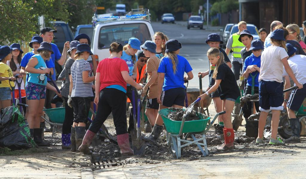 Student Volunteer Army is out in clean up mode again after the weeks flooding. Heathcote Valley residents are benefiting from the Army's resources with mud removal. Students from Heathcote Valley School are also helping.