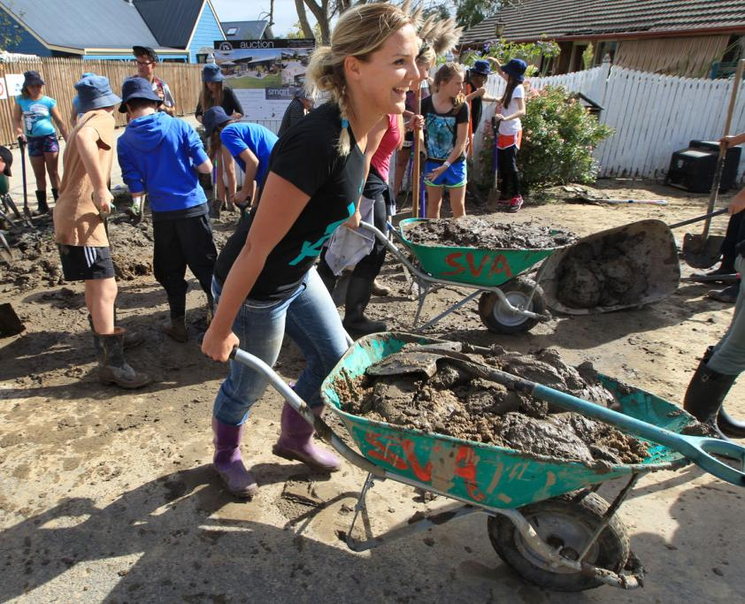 Student Volunteer Army is out in clean up mode again after the weeks flooding. Heathcote Valley residents are benefiting from the Army's resources with mud removal. Canterbury University student Hannah Livingstone is on wheelbarrow duty.