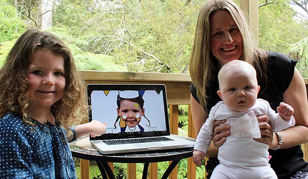 FEELING FAMOUS: Poppy Simpson-Glover, 4, checks herself out on screen with television producer mum Belinda Simpson and sister Jessie-Rose Simpson-Glover, four months.
