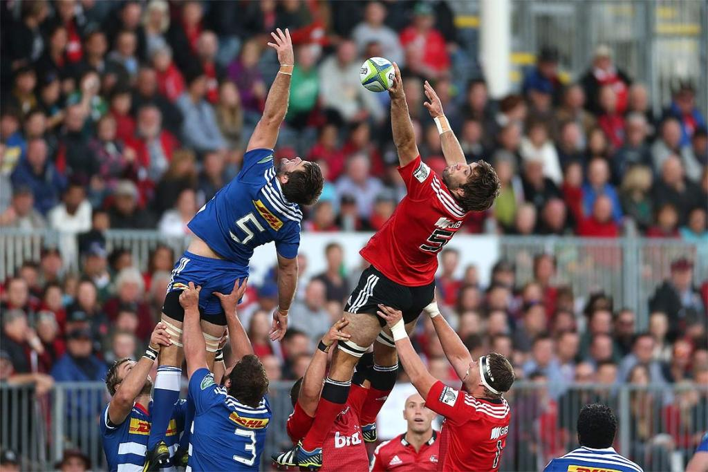 Sam Whitelock reaches highest to claim lineout ball for the Crusaders against the Chiefs.