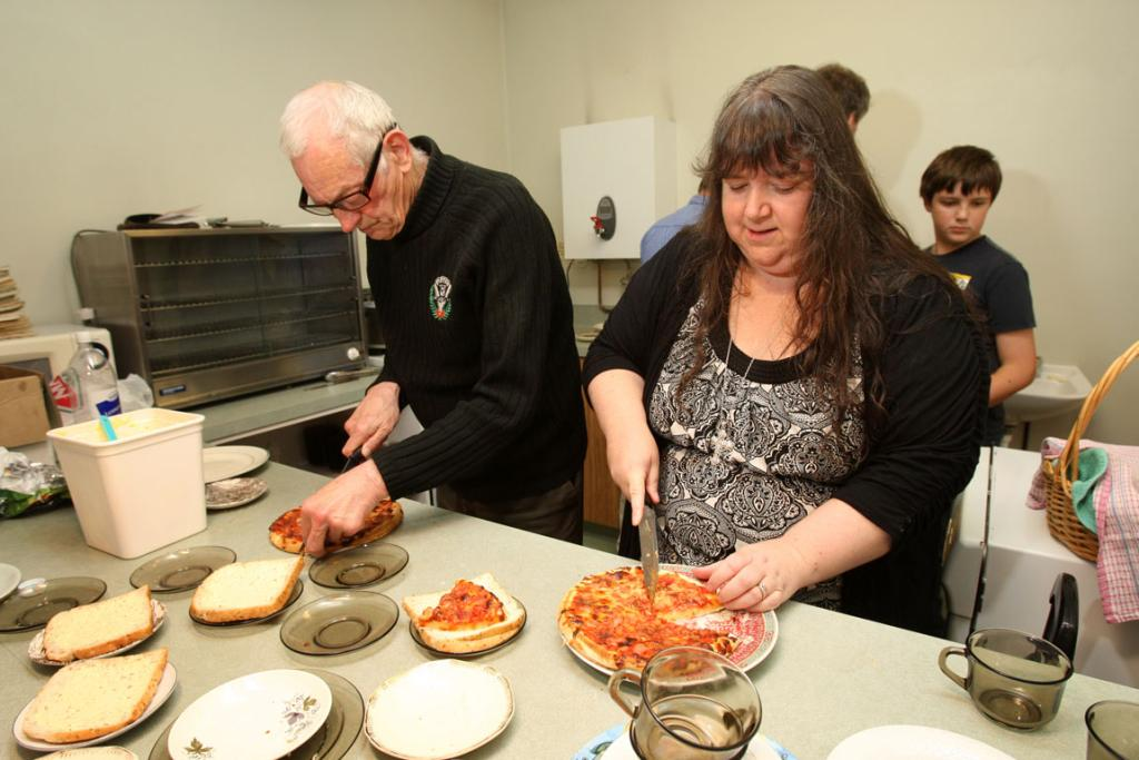 Bill Butler and Janine de Ruyter volunteer at the soup kitchen in St Mary's Hall.