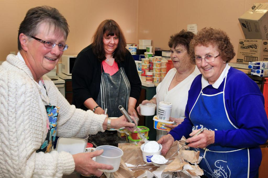 St John's parish soup kitchen Ann Piercy, Linda Burgess, Joan Marshall and Jennifer Phillipson divide out donated supplies to give out during the soup kitchen each Friday.