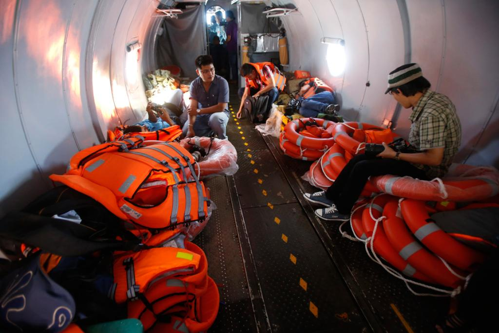 Life vests and lifesavers are seen onboard a Vietnam Air Force search and rescue aircraft on a mission to find the missing Malaysia Airlines flight MH370, off Tho Chu island.