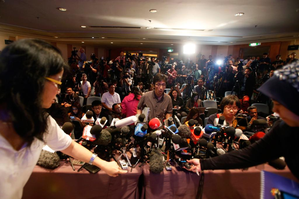 Journalists place their recorders as they get ready for the first briefing of the day at a news conference at the Kuala Lumpur International Airport in Sepang on March 10.