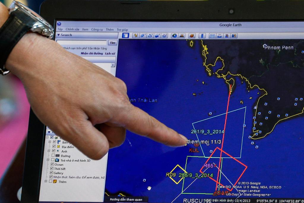 A map of a flight plan is seen on a computer screen during a meeting before a mission to find the Malaysia Airlines flight MH370 that disappeared from radar screens in the early hours of Saturday, at Phu Quoc Airport.