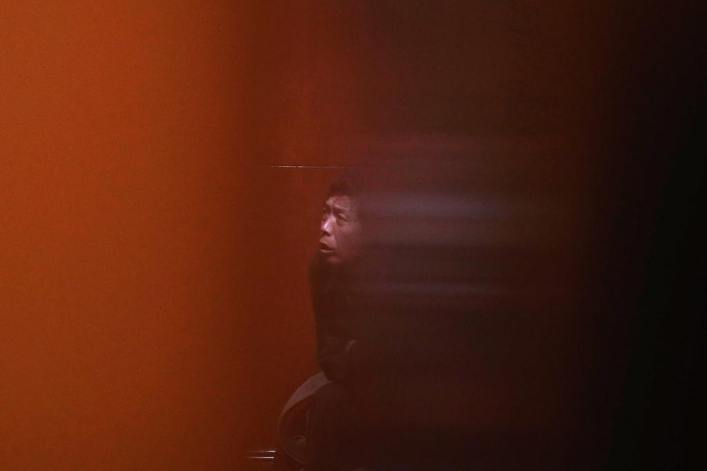A family member of a passenger from the missing Malaysia Airlines flight MH370 waits for news at Lido Hotel on March 10, in Beijing, China. Investigative teams continue to search for the missing Malaysia Airlines flight MH370 and the 293 passengers that were travelling from Kuala Lumpur to Beijing.