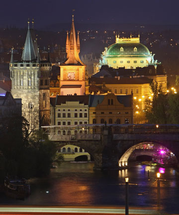 PRAGUE AT NIGHT: Illuminated buildings in Old Town, including one of the Charles Bridge towers (L) and the National Theatre (R).