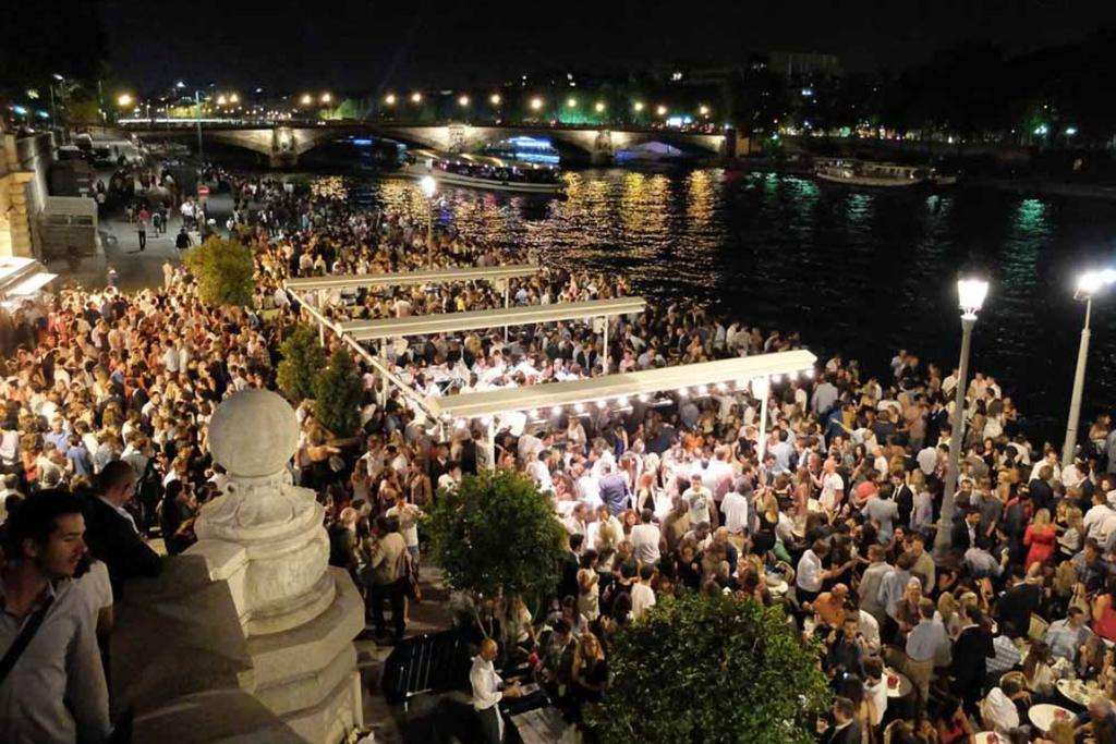 A party at night on the River Seine.