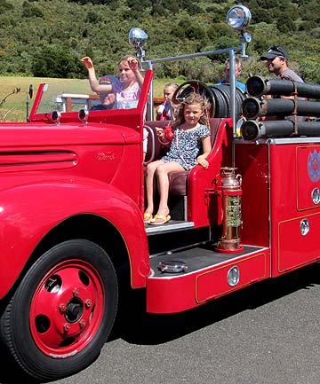 SPECIAL OUTING: Fire chief Ron Leonard takes families for rides in his own vintage fire truck.
