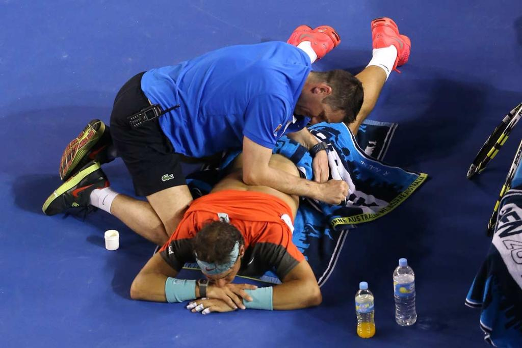Rafa Nadal receives treatment on his injured back during the men's singles final.