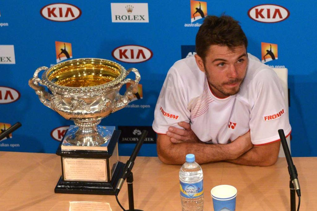 Stanislas Wawrinka sits with the Australian Open trophy at the post-final press conference.
