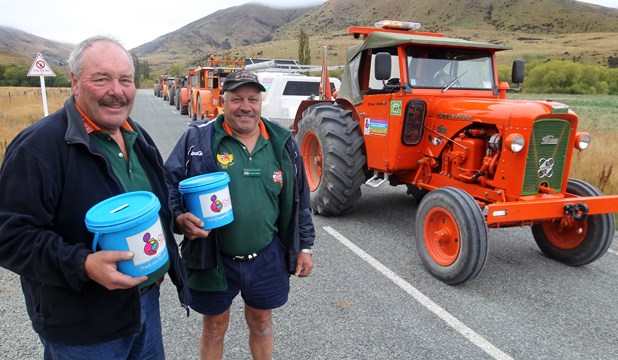 TRACTOR TREKKERS: Lead drivers for the day on the tractor trek, Steve Day, left, and Claude Fuller with their Child Cancer Foundation collection buckets as they stopped on their way to Fairlie yesterday.