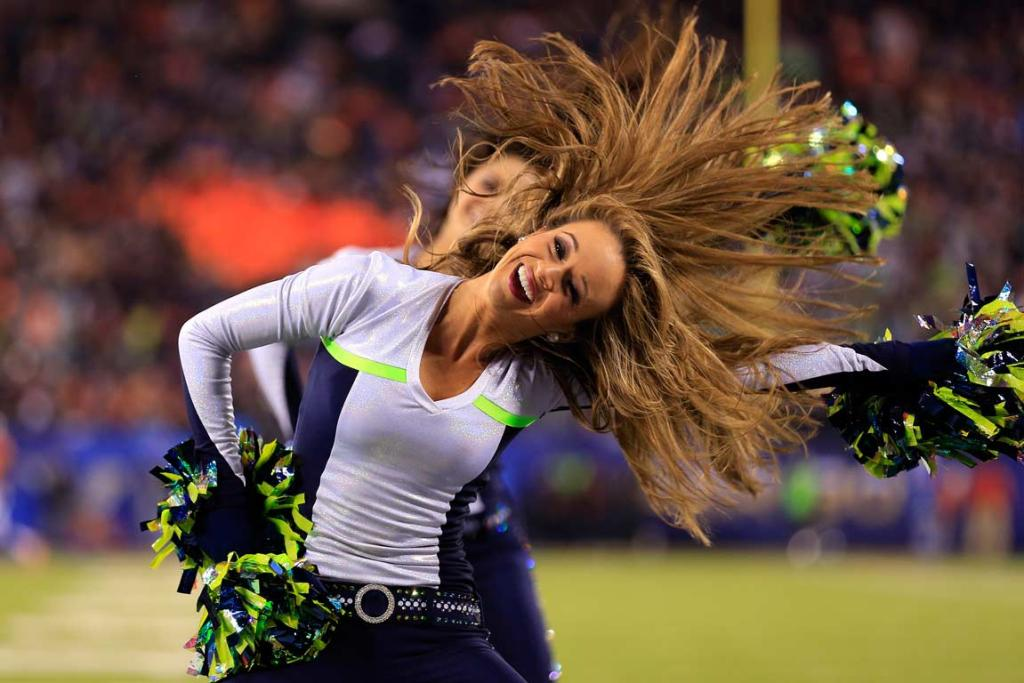 A Seahawks cheerleader in action during the frigid Super Bowl XLVIII.