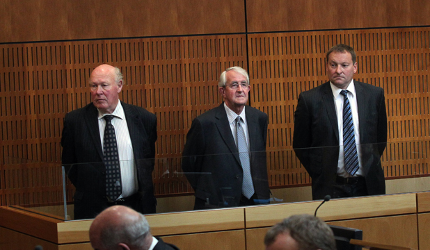TRIAL STARTS: Arraigned in the dock at the start of the $1.58b South Canterbury Finance fraud case, from left, are Edward Sullivan, Robert White and Lachie McLeod.