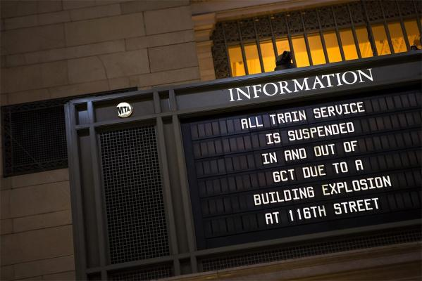 A sign warns of delays at Manhattan's Grand Central terminal after the blast in East Harlem.