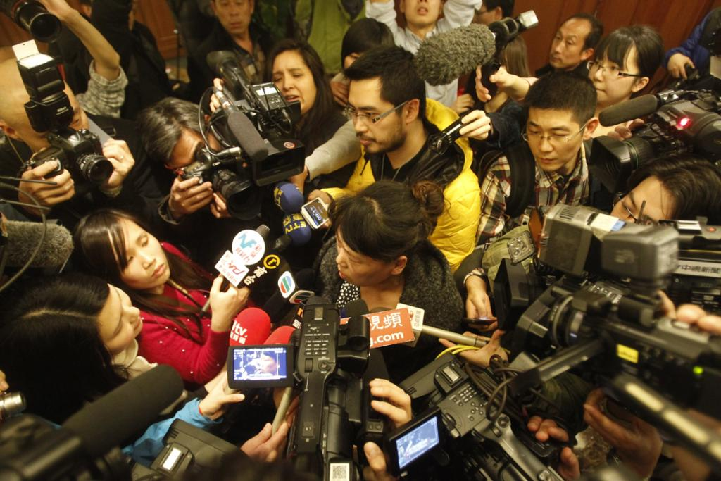 A relative of a passenger aboard Malaysia Airlines flight MH370 answers media questions at Lido Hotel.