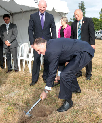 FIRST STEP: Prime Minister John Key turns the first sod of the new Endeavour Avenue Primary School in Flagstaff.