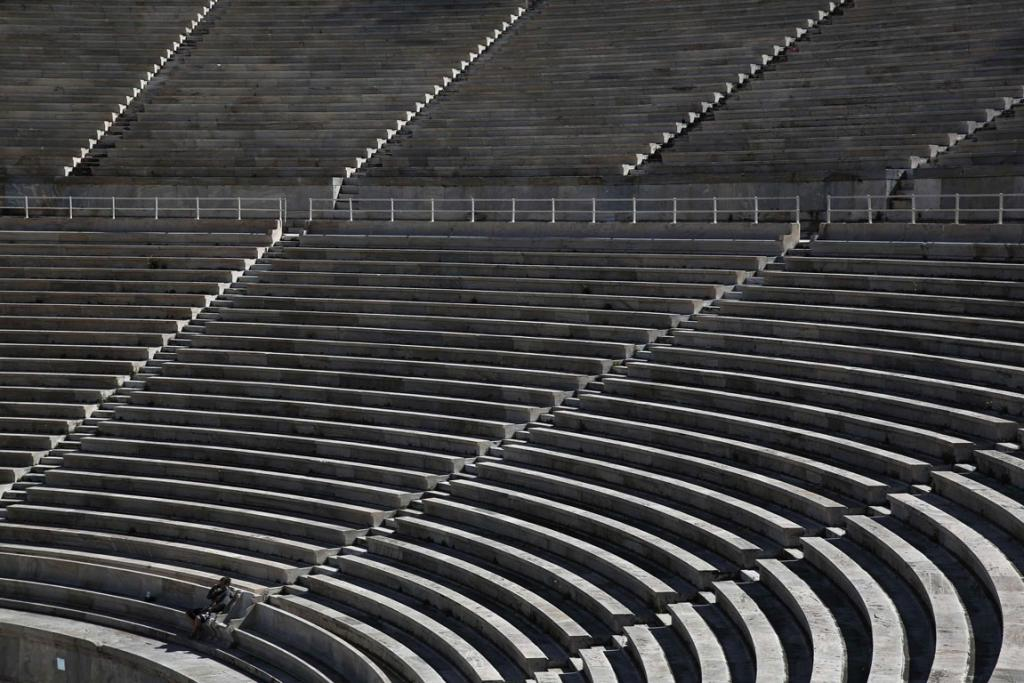 A tourist visits the Panathenean stadium, the stadium which hosted the first modern Olympics in 1896, in Athens.