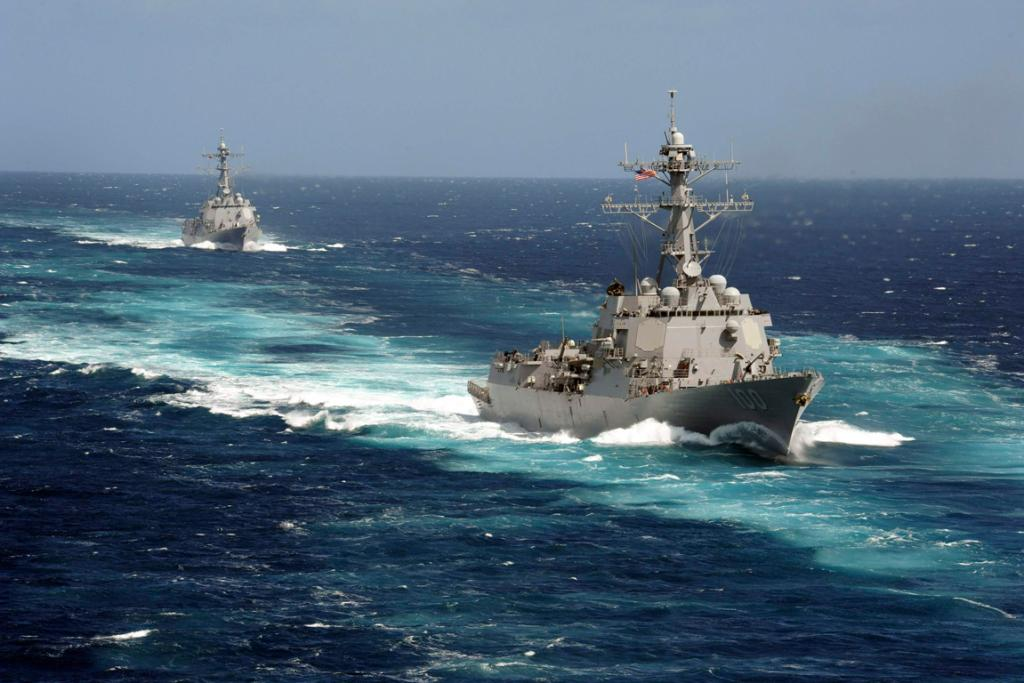 The Arleigh Burke-class guided-missile destroyers USS Kidd and USS Pinckney are seen en transit in the Pacific Ocean in this US Navy picture taken May 18, 2011.  Kidd and Pinkney have been searching for the missing Malaysian airliner and are being re-deployed to the Strait of Malacca off Malaysia's west coast as new search areas are opened in the Indian Ocean.