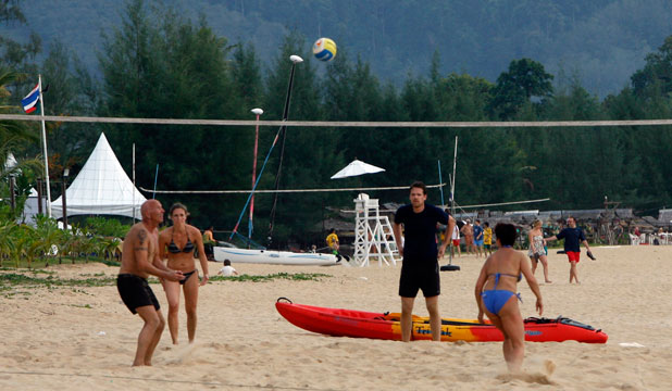 A WORLD AWAY: Tourists play volleyball on Khao Lak beach in Thailand's Phang Nga province.