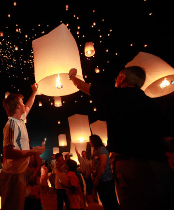 IN MEMORY: People launch floating paper lanterns into the sky over the Andaman Sea in remembrance of the 2004 Indian Ocean tsunami victims, in Khao Lak.