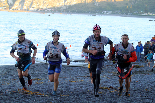 We've done it: Team Absolute Wilderness NZ are all smiles as they arrive at the finish in Kaikoura to claim third place in the 2014 GodZone adventure race. From left, Dan Moore (Marlborough), Naomi Whitehead, Dan Busch (Nelson) and Jeremy McKenzie (Marlborough).