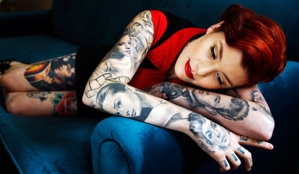 A TRUE PASSION: Amie Golding says she regrets her first tattoo, but that certainly didn't stop her getting more.