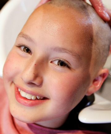 GOOD CAUSE: Alessandra Tobin has her hair shorn off for Shave for a Cure. ''I can run faster and swim faster.''