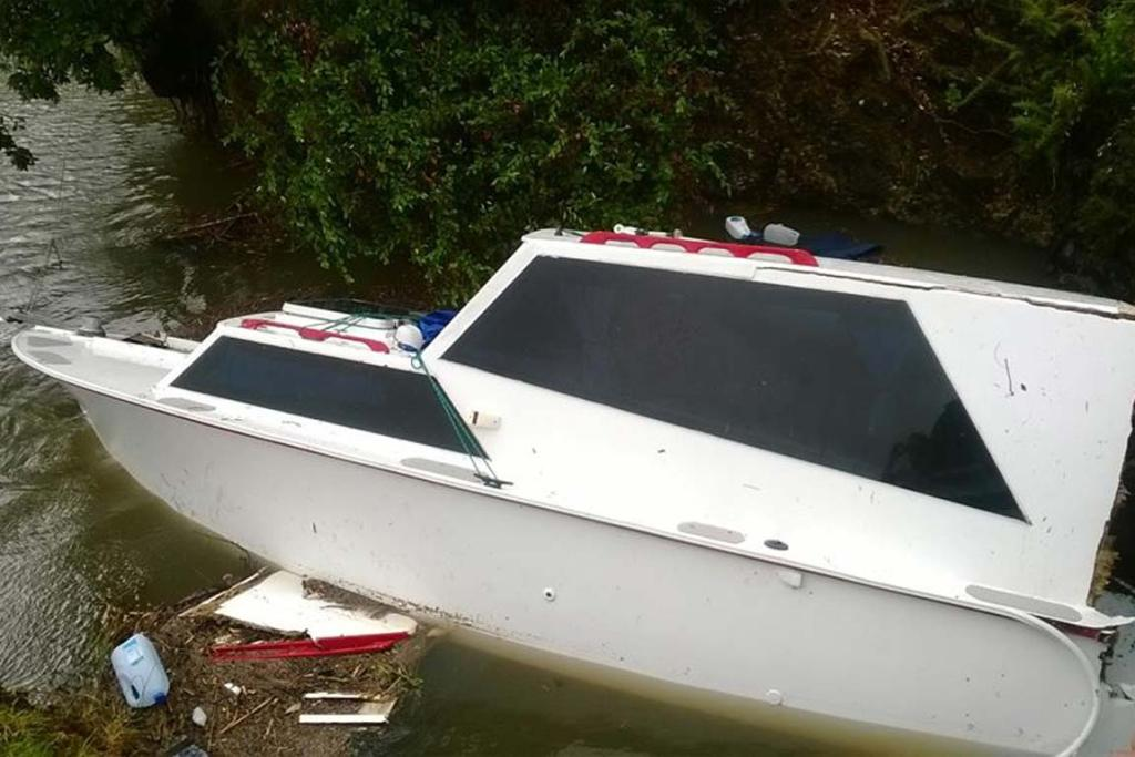 A boat washed away in Paihia.
