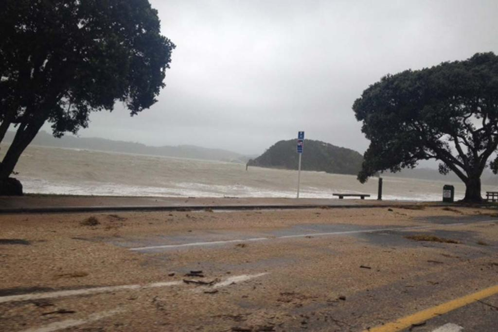 The wind, rain and high seas are washing debris over many roads.