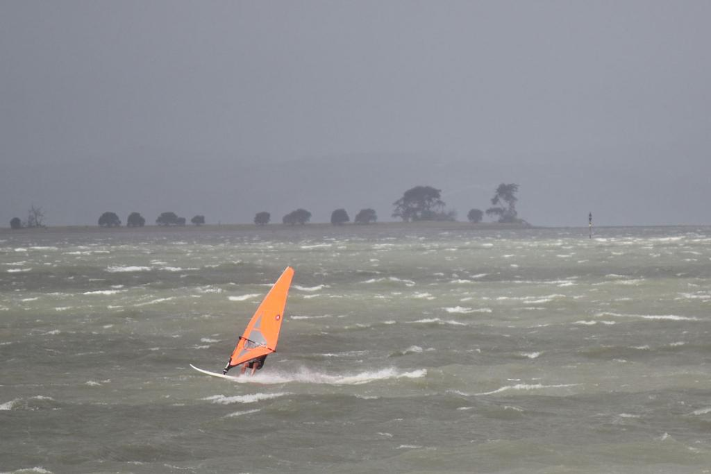 A windsurfer makes the most of gales off the eastern beaches.