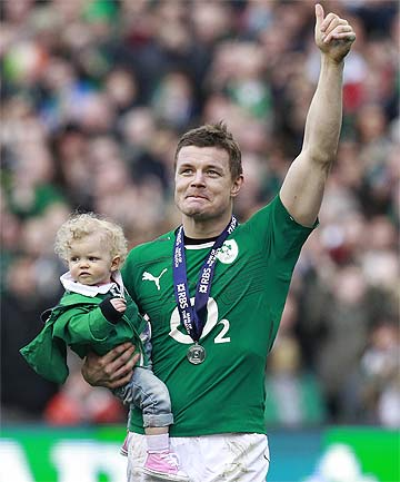 PURE CLASS: Ireland's Brian O'Driscoll holds his young daughter as he says goodbye to Irish fans on his last home appearance.