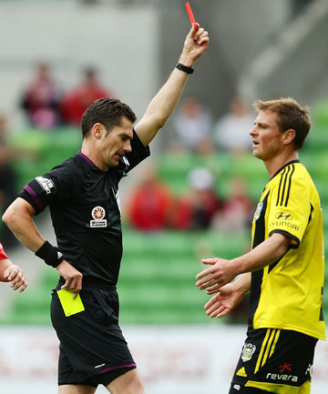 DISMISSED: Ben Sigmund is sent off after receiving a second yellow card in the Phoenix's draw with Melbourne Heart.