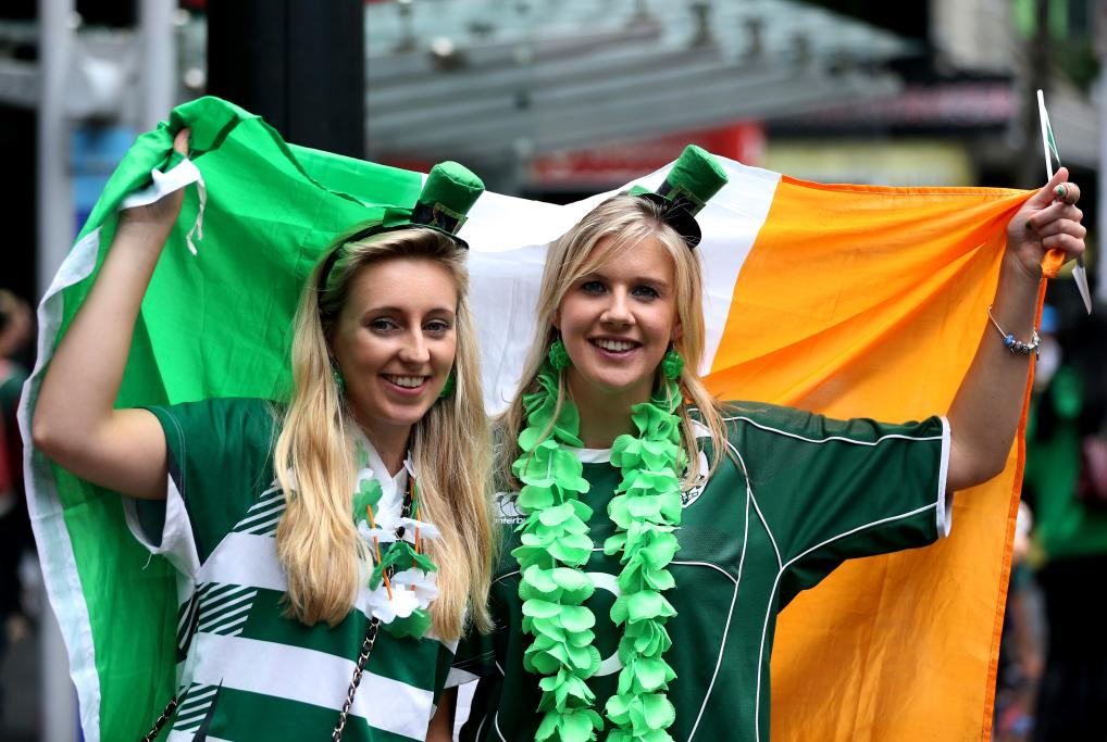 Emma-Louise O'Regan (left) and Deidre Collins, both from Cork enjoy the St Patrick's Parade on Auckland's Queen Street on Sunday afternoon.